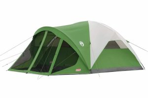 Green and white Coleman Dome Tent with a screen room at front