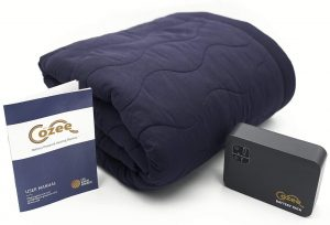 The Cozee dark blue heated blanket with a battery pack and manual