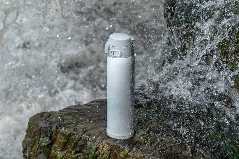 Insulated water bottle at a water fall