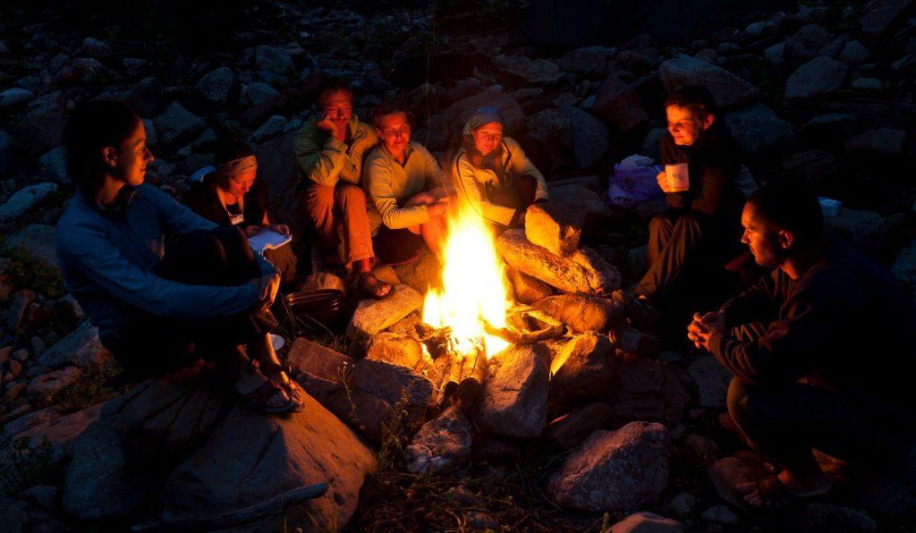 Group of friends enjoying a camp fire