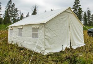 Elk Mountain Wall Tent set up in nature with cloudy weather