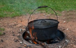 Dutch oven sitting on a camp fire