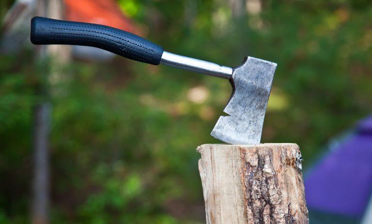 Hatchet in a wooden chopping block